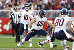 FILE - In this Dec. 23, 2018, file photo, Chicago Bears quarterback Mitchell Trubisky (10) passes behind the blocking of center Cody Whitehair (65) during the second half of an NFL football game against the San Francisco 49ers in Santa Clara, Calif. Some might argue the center is the most indispensable player on the roster, the player who mans the only position guaranteed to touch the ball on every play. He calls the shots for the line and gets the action going.(AP Photo/D. Ross Cameron, File)