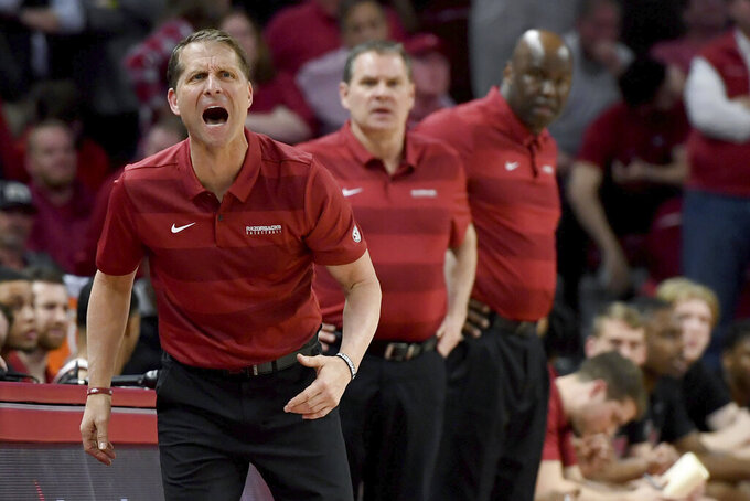 FILE - Arkansas coach Eric Musselman reacts on the sidelines against LSU during the first half of an NCAA college basketball game in Fayetteville, Ark., in this March 4, 2020, file photo. Arkansas will have a distinctly different look this season. Isaiah Joe and Mason Jones left school early and declared for the NBA Draft, leaving the Razorbacks without their combined 39 points per game. A host of newcomers will have opportunities for second-year coach Musselman. (AP Photo/Michael Woods, FIle)