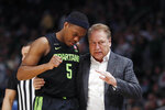 Michigan State head coach Tom Izzo talks with guard Cassius Winston during the second half of an NCAA college basketball game, Saturday, Dec. 14, 2019, in Detroit. (AP Photo/Carlos Osorio)