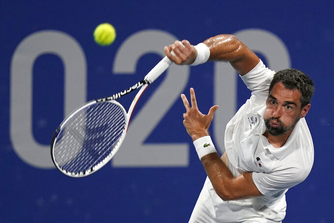 Jeremy Chardy, of France, serves to Alexander Zverev, of Germany, during the quarterfinal round of the men's tennis competition at the 2020 Summer Olympics, Thursday, July 29, 2021, in Tokyo, Japan. (AP Photo/Patrick Semansky)
