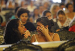 A woman wipes away tears during a memorial Mass to mark the one-year death anniversary of slain councilwoman Marielle Franco, at the Candelaria Catholic Church in Rio de Janeiro, Brazil, Thursday, March 14, 2019. Franco and her driver, Anderson Gomes, were gunned down in Central Rio, a brazen assassination that shocked Brazilians and sparked protests in several countries. (AP Photo/Silvia Izquierdo)