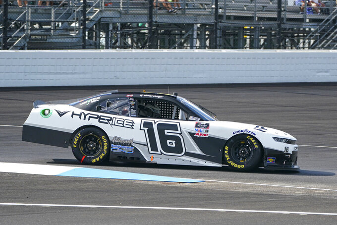AJ Allmendinger (16) drives through the first turn during the NASCAR Xfinity Series auto race at Indianapolis Motor Speedway in Indianapolis, Saturday, Aug. 14, 2021. (AP Photo/Michael Conroy)