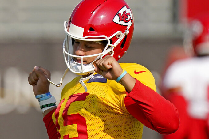 Kansas City Chiefs quarterback Patrick Mahomes stretches during an NFL football training camp practice Monday, Aug. 24, 2020, in Kansas City, Mo. (AP Photo/Charlie Riedel)