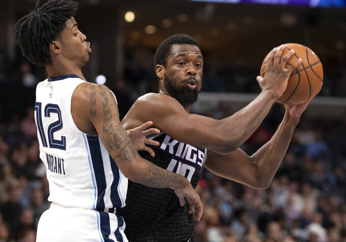 FILE - In this Feb. 28, 2020, file photo, Sacramento Kings forward Harrison Barnes (40) looks to pass while defended by Memphis Grizzlies guard Ja Morant (12) during the first half of an NBA basketball game in Memphis, Tenn. Harrison Barnes became the latest NBA player to reveal that he has coronavirus, making the announcement Tuesday, July 14, 2020, and saying he has hopes to join his team at the league's restart later this summer. (AP Photo/Nikki Boertman, File)