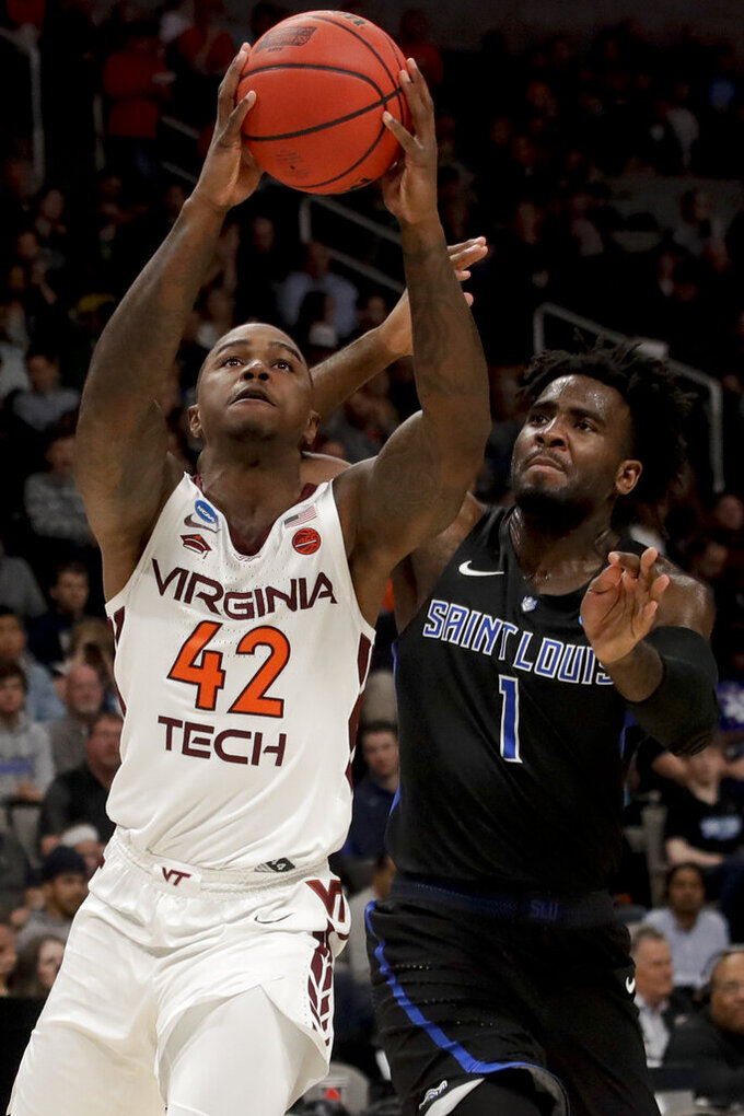 Virginia Tech guard Ty Outlaw shoots past Saint Louis forward D.J. Foreman during the first half of a first-round game in the NCAA men's college basketball tournament Friday, March 22, 2019, in San Jose, Calif. (AP Photo/Jeff Chiu)