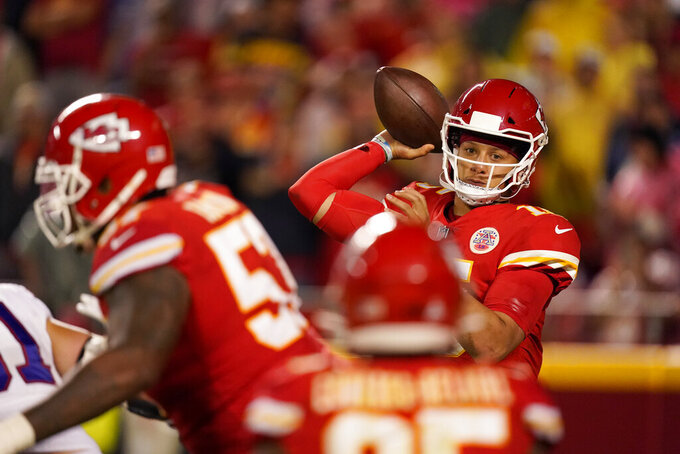 Kansas City Chiefs quarterback Patrick Mahomes throws during the second half of an NFL football game against the Buffalo Bills Sunday, Oct. 10, 2021, in Kansas City, Mo. (AP Photo/Charlie Riedel)