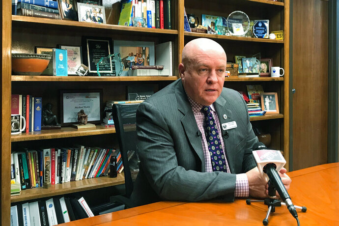 Little Rock School District Superintendent Michael Poore speaks to reporters at the district's offices in Little Rock, Ark. on Monday, Nov. 11, 2019. Teachers in the 23,000-student district have announced they plan a one-day strike this week. (AP Photo/Andrew Demillo)