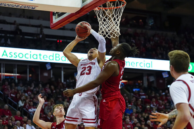 Wisconsin's Kobe King (23) shoots against Nebraska's Yvan Ouedraogo during the second half of an NCAA college basketball game Tuesday, Jan. 21, 2020, in Madison, Wis. Wisconsin won 82-68. (AP Photo/Andy Manis)