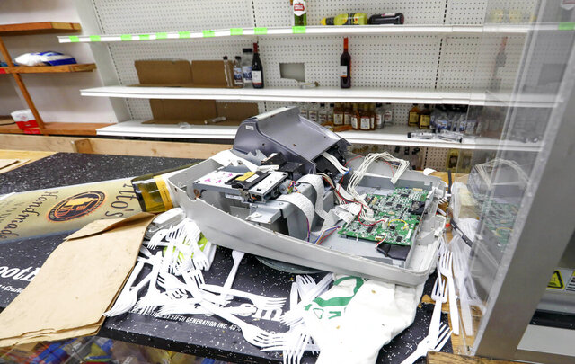 A broken cash register sits on the counter of African Food & Liquor in Chicago, Thursday, Aug. 13, 2020. The West Side convenience store was ransacked Monday just hours after Chicago Mayor Lori Lightfoot warned vandals that the city will hold them accountable for ransacking downtown retailers earlier that day. It was the second time since May that the neighborhood store was vandalized. (AP Photo/Teresa Crawford)