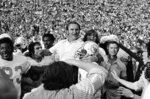 FILE - In this Jan. 14, 1973 file photo, Miami Dolphins coach Don Shula is carried off the field after his team the won NFL football Super Bowl game with a 14-7 victory over Washington Redskins in Los Angeles. The perfection of the 1972 Miami Dolphins has earned them the nod as the NFL's greatest team. The 1972 Dolphins edged the 1985 Chicago Bears for the NFL's greatest team in balloting by 59 national media members as part of the NFL's celebration of its 100th season. (AP Photo/File)