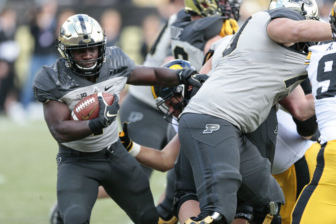 Purdue running back D.J. Knox (1) runs behind the line of scrimmage while playing Iowa in the first half of an NCAA college football game in West Lafayette, Ind., Saturday, Nov. 3, 2018. Purdue won 38-36. (AP Photo/AJ Mast)