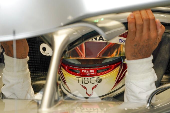 Mercedes driver Lewis Hamilton of Britain prepares for the first practice session at the Marina Bay City Circuit ahead of the Singapore Formula One Grand Prix in Singapore, Friday, Sept. 20, 2019. (AP Photo/Vincent Thian)
