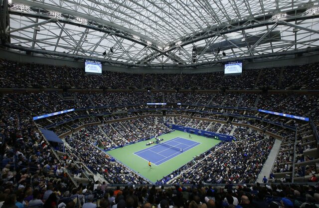 """FILE - This is a Sept. 9, 2018, file photo showing Novak Djokovic, of Serbia, and Juan Martin del Potro, of Argentina, playing in the men's final of the U.S. Open tennis tournament in New York. The Citi Open in Washington, scheduled to start with Aug. 13 qualifying, was called off Tuesday, July 21, 2020, because of what tournament manager Mark Ein said are """"too many unresolved external issues, including various international travel restrictions as well as troubling health and safety trends."""" With Washington's hard-court tournament now gone, the first chance for men to play sanctioned matches will be the Masters-level event usually played in Cincinnati that was moved to the site of the U.S. Open, starting Aug. 22. (AP Photo/Jason DeCrow, File)"""