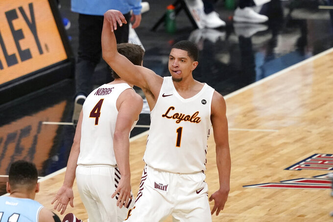 Loyola of Chicago's Lucas Williamson celebrates after making a 3-point basket during the second half of an NCAA college basketball game against Indiana State in the semifinal round of the Missouri Valley Conference men's tournament Saturday, March 6, 2021, in St. Louis. (AP Photo/Jeff Roberson)