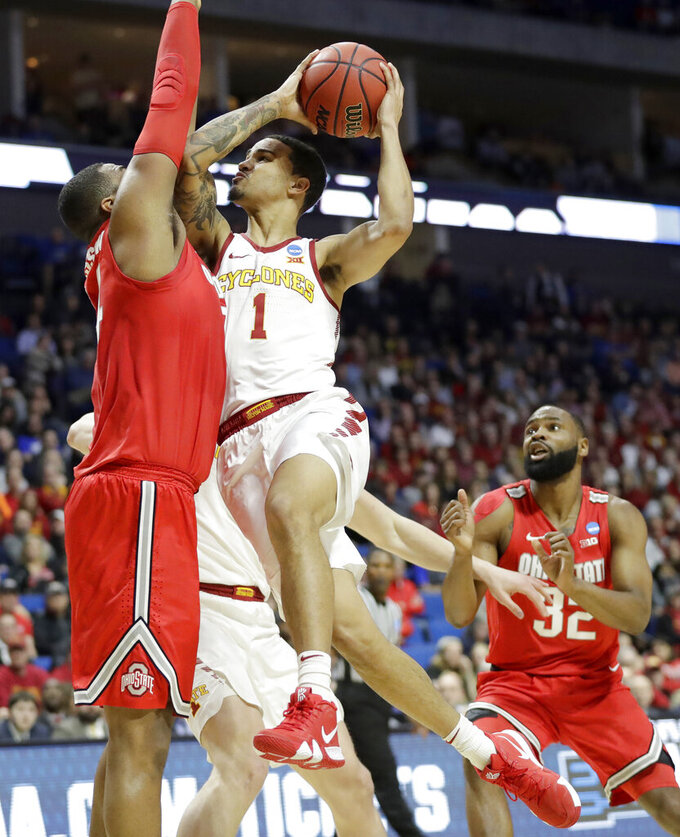 Iowa State's Nick Weiler-Babb (1) heads to the basket as Ohio State's Kaleb Wesson, left, and Keyshawn Woods (32) defend during the first half of a first round men's college basketball game in the NCAA Tournament Friday, March 22, 2019, in Tulsa, Okla. (AP Photo/Jeff Roberson)