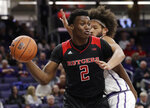 Rutgers center Shaquille Doorson, left, looks to pass as Northwestern center Barret Benson defends during the first half of an NCAA college basketball game, Wednesday, Feb. 13, 2019, in Evanston, Ill. (AP Photo/Nam Y. Huh)