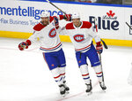 Montreal Canadiens' Shea Weber (6) and Joel Armia (40) celebrate a goal against the Buffalo Sabres during the first period of an NHL hockey game Wednesday, Oct. 9, 2019, in Buffalo, N.Y. (AP Photo/Jeffrey T. Barnes)