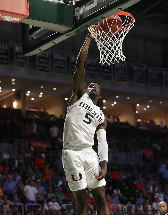 Miami guard Zach Johnson shoots during the second half of an NCAA college basketball game against North Carolina on Saturday, Jan. 19, 2019, in Coral Gables, Fla. (AP Photo/Brynn Anderson)