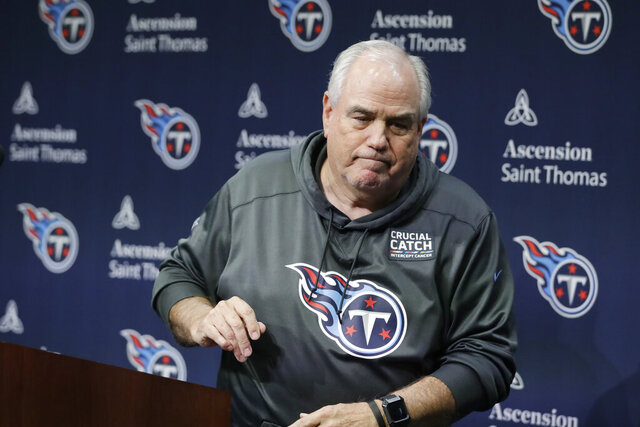 Tennessee Titans defensive coordinator Dean Pees leaves the podium after announcing he will be retiring from football Monday, Jan. 20, 2020, in Nashville, Tenn. Pees just finished his second season with the Titans as defensive coordinator, and his 47th year in coaching. (AP Photo/Mark Humphrey)