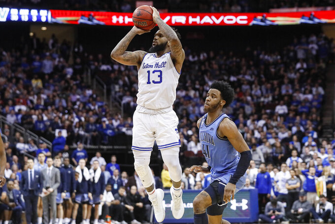 Seton Hall's Myles Powell (13) shoots against Villanova's Saddiq Bey (41) during the second half of an NCAA college basketball game Wednesday, March 4, 2020, in Newark, N.J. (AP Photo/John Minchillo)