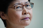 Hong Kong Chief Executive Carrie Lam, listens to reporters questions during a press conference at the government building in Hong Kong Tuesday, Sept. 10, 2019. Hong Kong leader Lam renews an appeal to pro-democracy protesters to halt violence and engage in dialogue, as the city's richest man urged the government to provide a way out for the mostly young demonstrators. (AP Photo/Vincent Yu)