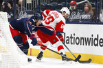 Detroit Red Wings' Sam Gagner, right, tries to control the puck as Columbus Blue Jackets' Michael Del Zotto defends during the first period of an NHL hockey game Tuesday, April 27, 2021, in Columbus, Ohio. (AP Photo/Jay LaPrete)