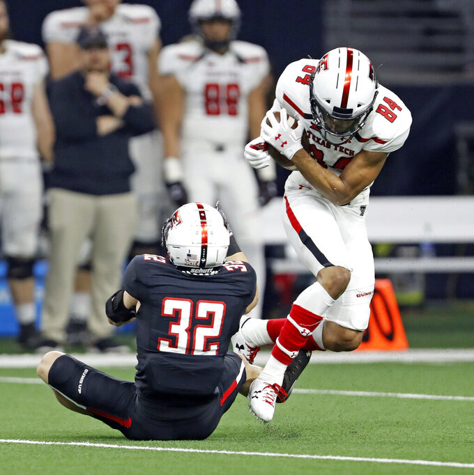Texas Tech's Erik Ezukanma (84) breaks away from Jake Kirkpatrick (32) during an NCAA college football spring game, Saturday, April 13, 2019, in Frisco, Texas. (Brad Tollefson/Lubbock Avalanche-Journal via AP)