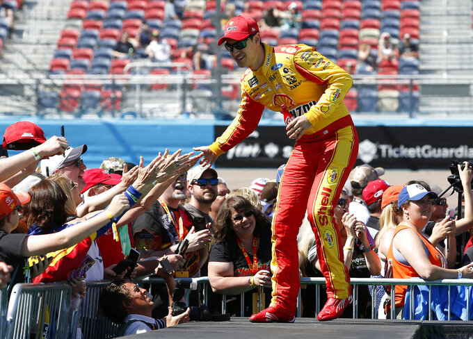 Joey Logano is greeted by fans during driver introductions prior to the start of the NASCAR Cup Series auto race at ISM Raceway, Sunday, March 10, 2019, in Avondale, Ariz. (AP Photo/Ralph Freso)