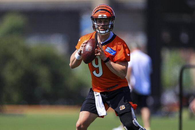 Cincinnati Bengals Joe Burrow looks to pass during NFL football practice in Cincinnati, Tuesday, May 25, 2021. (AP Photo/Aaron Doster)