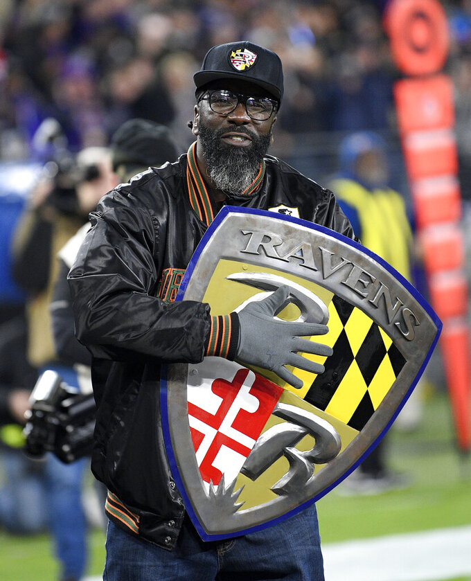 Former Baltimore Ravens safety Ed Reed is introduced onto the field prior to an NFL football game against the New England Patriots, Sunday, Nov. 3, 2019, in Baltimore. (AP Photo/Nick Wass)