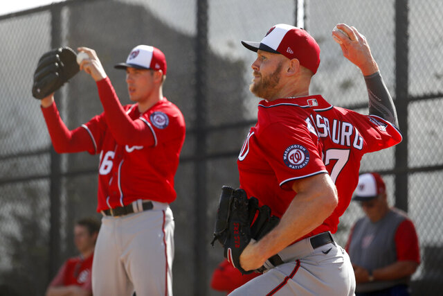 Washington Nationals pitchers Stephen Strasburg, right, and Patrick Corbin throw bullpen sessions during spring training baseball practice Friday, Feb. 14, 2020, in West Palm Beach, Fla. (AP Photo/Jeff Roberson)