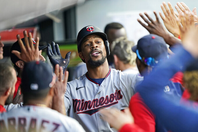 Minnesota Twins' Byron Buxton celebrates with teammates after hitting a solo home run in the fifth inning of a baseball game against the Cleveland Indians, Monday, Sept. 6, 2021, in Cleveland. (AP Photo/Tony Dejak)
