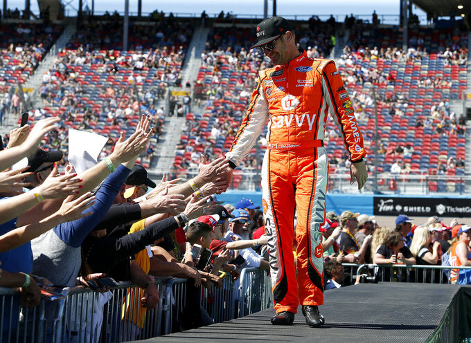 Clint Bowyer is greeted by fans during driver introductions prior to the start of the NASCAR Cup Series auto race at ISM Raceway, Sunday, March 10, 2019, in Avondale, Ariz. (AP Photo/Ralph Freso)