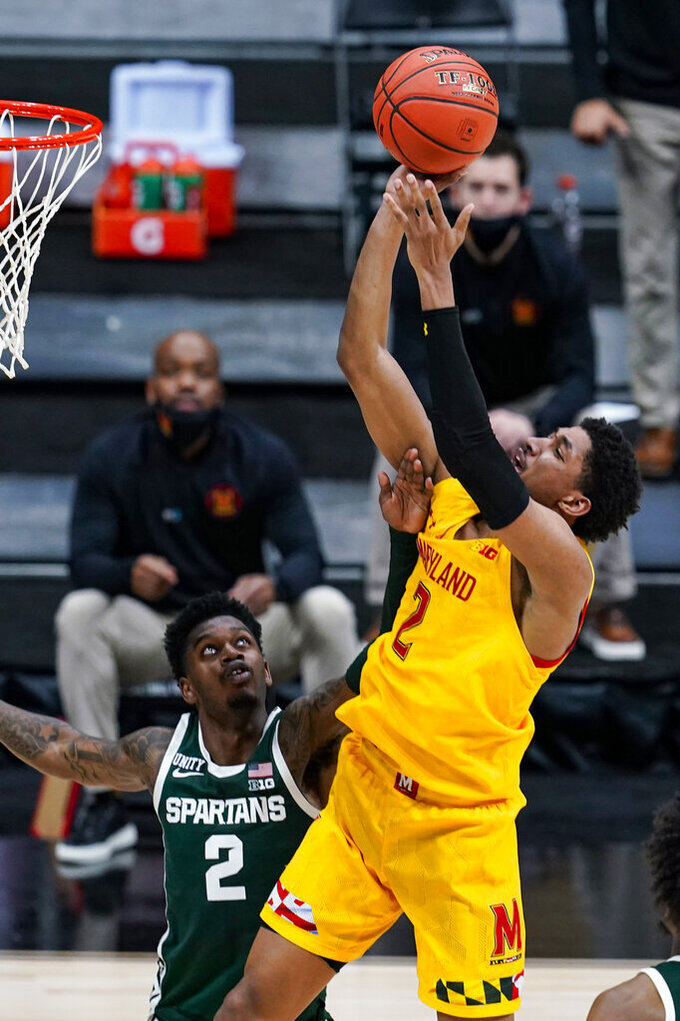 Maryland guard Aaron Wiggins (2) shoots in front of Michigan State guard Rocket Watts (2) in the second half of an NCAA college basketball game at the Big Ten Conference tournament in Indianapolis, Thursday, March 11, 2021. Maryland defeated Michigan State 68-57. (AP Photo/Michael Conroy)