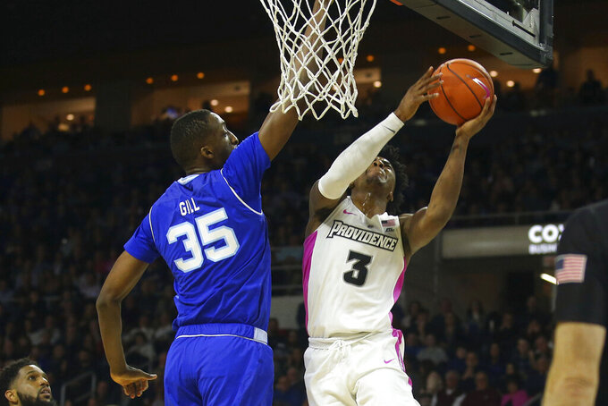 Seton Hall's Romaro Gill (35) blocks a shot by Providence's David Duke (3) during the second half of an NCAA college basketball game Saturday, Feb. 15, 2020, in Providence, R.I. (AP Photo/Stew Milne)