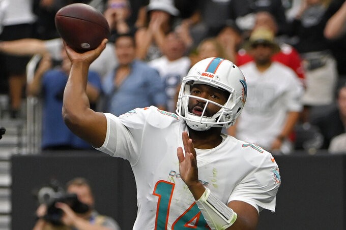 Miami Dolphins quarterback Jacoby Brissett (14) throws against the Las Vegas Raiders during the first half of an NFL football game, Sunday, Sept. 26, 2021, in Las Vegas. (AP Photo/David Becker)