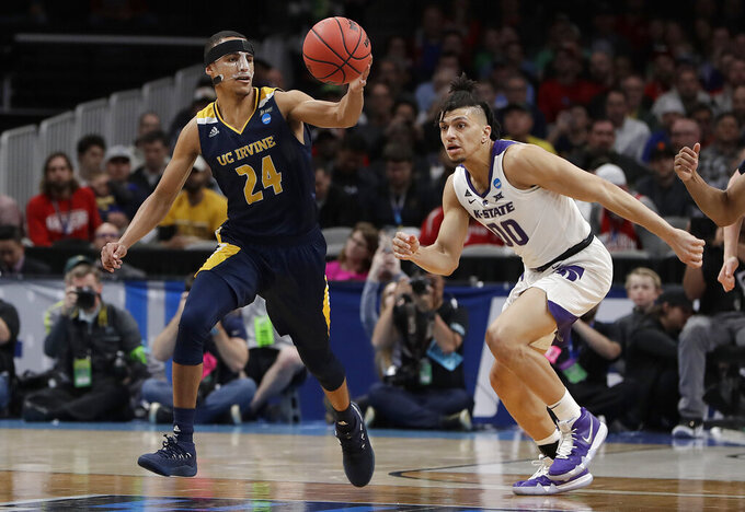 UC Irvine guard Eyassu Worku (24) grabs the ball in front of Kansas State guard Mike McGuirl during the second half of a first-round game in the NCAA men's college basketball tournament Friday, March 22, 2019, in San Jose, Calif. (AP Photo/Chris Carlson)