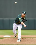 Oakland Athletics' Paul Blackburn throws against the Seattle Mariners during the first spring training baseball game of the season Thursday, Feb. 21, 2019, in Mesa, Ariz. (Dean Rutz/The Seattle Times via AP)
