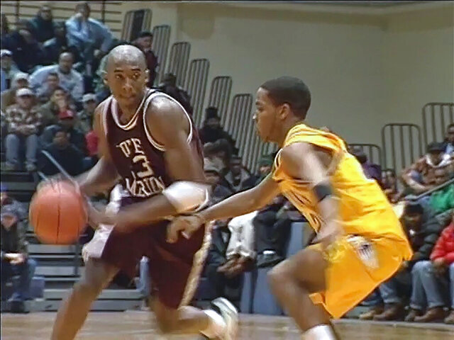This photo made from video and provided by Ross Online Productions, LLC, shows Kobe Bryant, left, from some of the 22 hours of footage of Kobe Bryant in high school that will be sold by the auction house Profiles in History on July 23, 2020. (Ross Online Productions, LLC via AP)