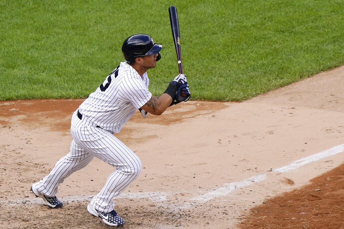 New York Yankees pinch hitter Gleyber Torres follows through on a two-run double to center field in the eighth inning of a baseball game against the Baltimore Orioles, Sunday, Sept. 13, 2020, at Yankee Stadium in New York. (AP Photo/Kathy Willens)