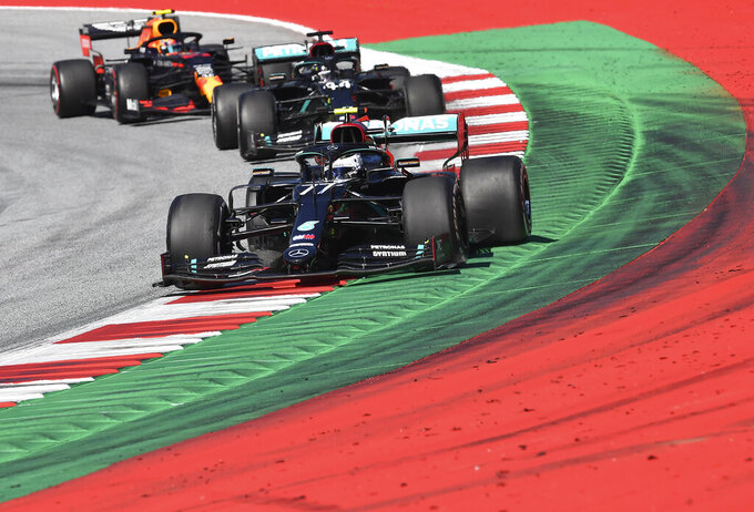 Mercedes driver Valtteri Bottas of Finland steers his car followed by Mercedes driver Lewis Hamilton of Britain and Red Bull driver Alexander Albon of Thailand during the Austrian Formula One Grand Prix at the Red Bull Ring racetrack in Spielberg, Austria, Sunday, July 5, 2020. (Joe Klamar/Pool via AP)