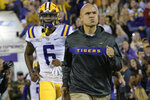 FILE - In this  Saturday, Nov. 23, 2019 file photo, LSU defensive coordinator Dave Aranda runs on the field against Arkansas in an NCAA college football game in Baton Rouge, La. Baylor is finalizing a deal to make LSU defensive coordinator Dave Aranda the new coach of the Bears, a person with knowledge of the agreement said Thursday, Jan. 16, 2020. The person spoke to The Associated Press on condition of anonymity because the school was not ready to make any official announcement on Matt Rhule's successor.(AP Photo/Matthew Hinton, File)