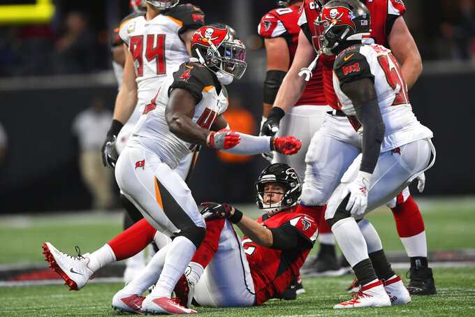 Atlanta Falcons quarterback Matt Ryan (2) lies on the turf after being sacked by the Tampa Bay Buccaneers during the first half of an NFL football game, Sunday, Nov. 24, 2019, in Atlanta. (AP Photo/John Amis)