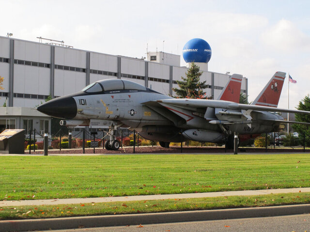 FILE - This Nov. 11, 2014 file photo shows a model of a fighter jet outside former Grumman Corp. plant in Bethpage, N.Y. Gov. Andrew Cuomo announced Sunday, Dec. 22, 2019 that if defense contractor Northrop Grumman and the U.S. Navy don't act swiftly, the state will start construction on its own on a system to contain and treat a nearly 7-square-mile swath of pollution from the former manufacturing facilities in Nassau County. (AP Photo/Frank Eltman, File)