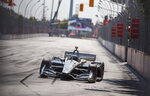 Simon Pagenaud, of France, drives his way to first place at the Honda Indy auto race in Toronto, Sunday, July 14, 2019. (Mark Blinch/The Canadian Press via AP)