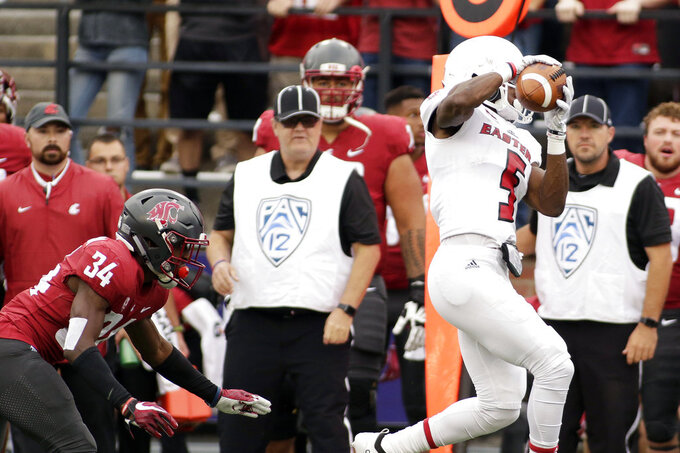 Eastern Washington wide receiver Nsimba Webster (5) catches a pass in front of Washington State safety Jalen Thompson (34) during the first half of an NCAA college football game in Pullman, Wash., Saturday, Sept. 15, 2018. (AP Photo/Young Kwak)