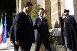 Chinese President Xi Jinping, left, and Italian Premier Giuseppe Conte meet at Rome's Villa Madama, Saturday, March 23, 2019. (AP Photo/Andrew Medichini)