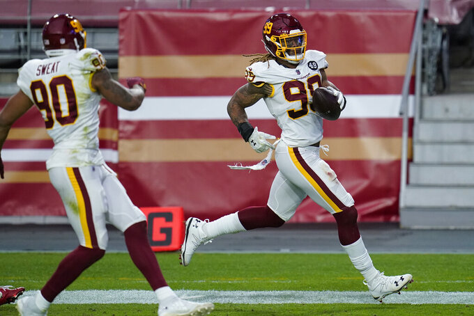 Washington Football Team defensive end Chase Young (99) scores a touchdown after recovering a fumble against the San Francisco 49ers during the first half of an NFL football game, Sunday, Dec. 13, 2020, in Glendale, Ariz. (AP Photo/Ross D. Franklin)