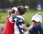 Jessica and Nelly Korda, right, of the U.S celebrate after winning 6 & 5 in the Foursomes match against Europe in the Solheim Cup at Gleneagles, Auchterarder, Scotland, Saturday, Sept. 14, 2019. (AP Photo/Peter Morrison)