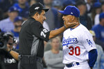 Los Angeles Dodgers manager Dave Roberts talks with home plate umpire Alfonso Marquez after the second inning in Game 5 of the baseball team's National League Division Series against the Washington Nationals on Wednesday, Oct. 9, 2019, in Los Angeles. (AP Photo/Mark J. Terrill)